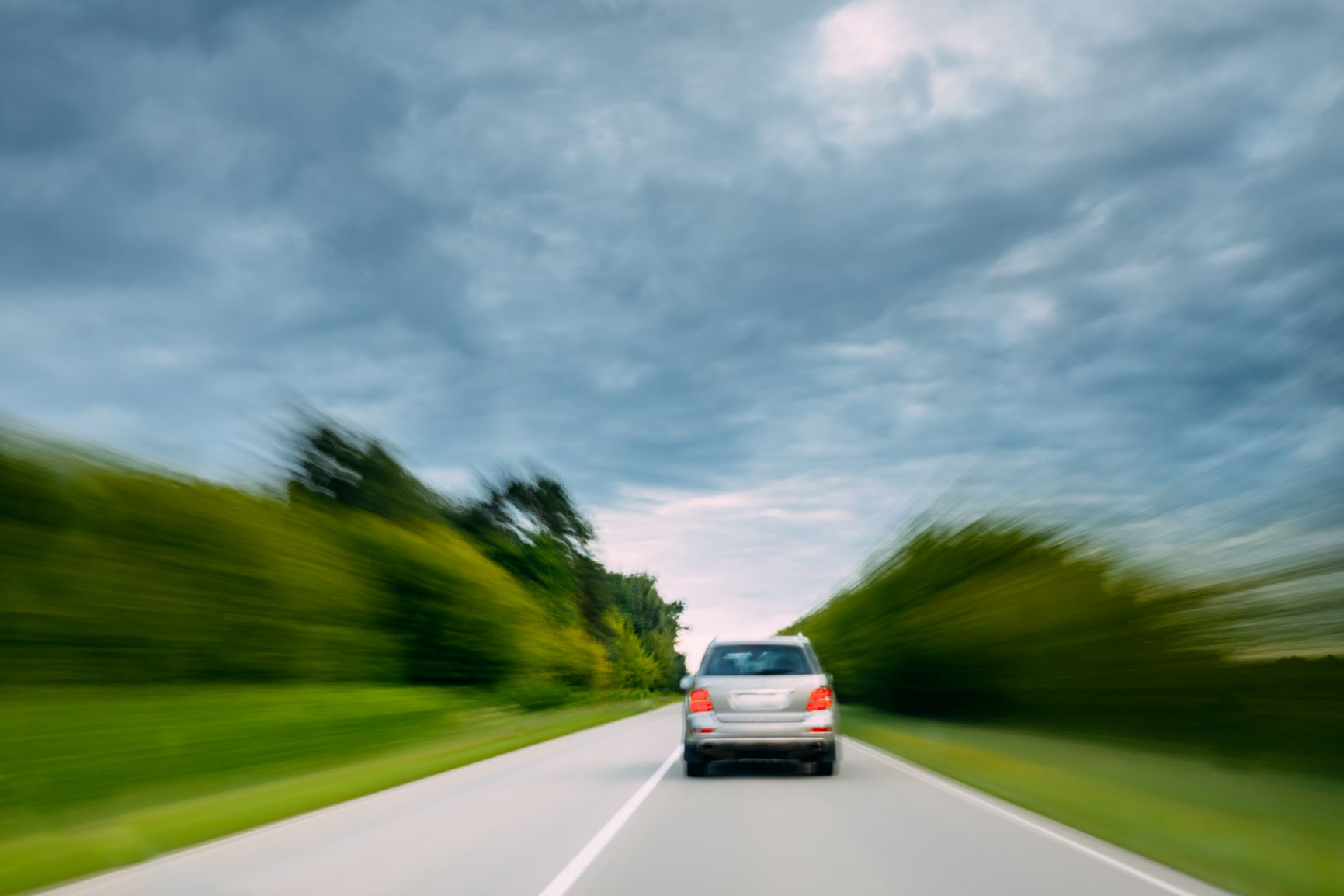 abstract natural blurred background of luxury suv PLC6MXJ
